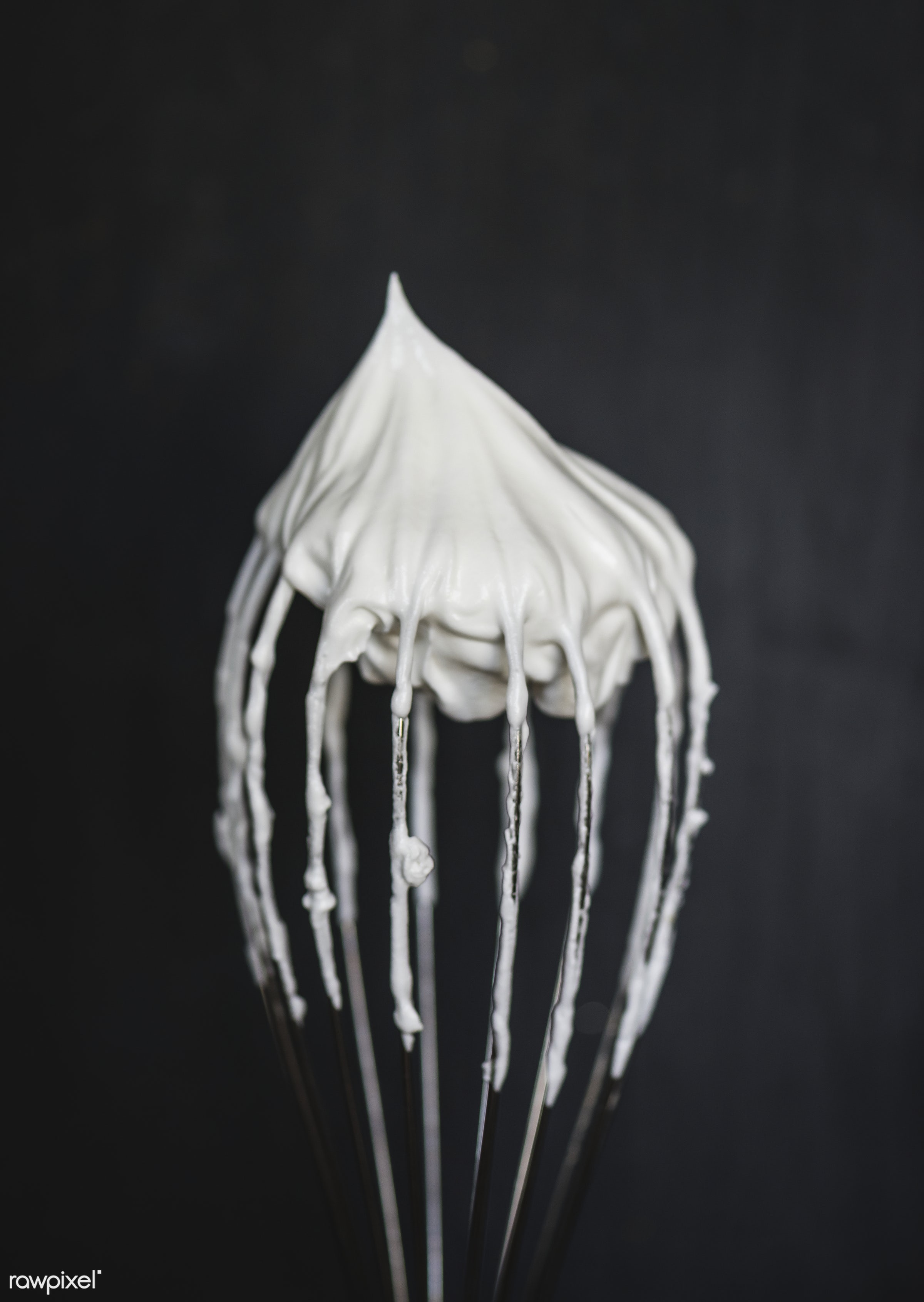 Close up of a wire whisk with whipped cream on top - ID: 415840