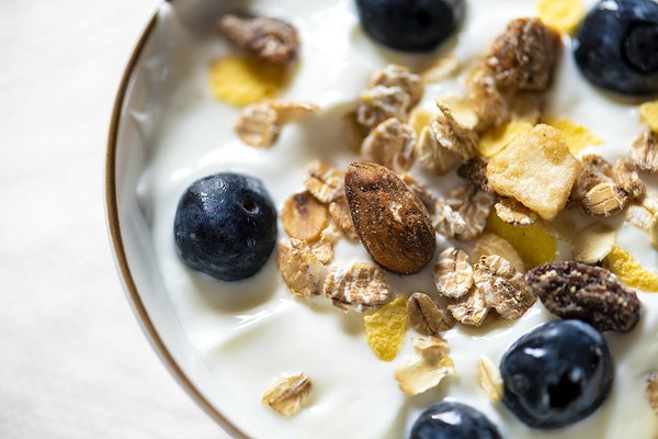 Bowl of yogurt with bluberries and granola