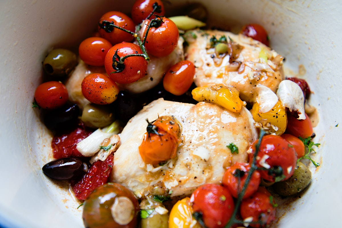 Roasted chicken and tomatoes food photography recipe idea