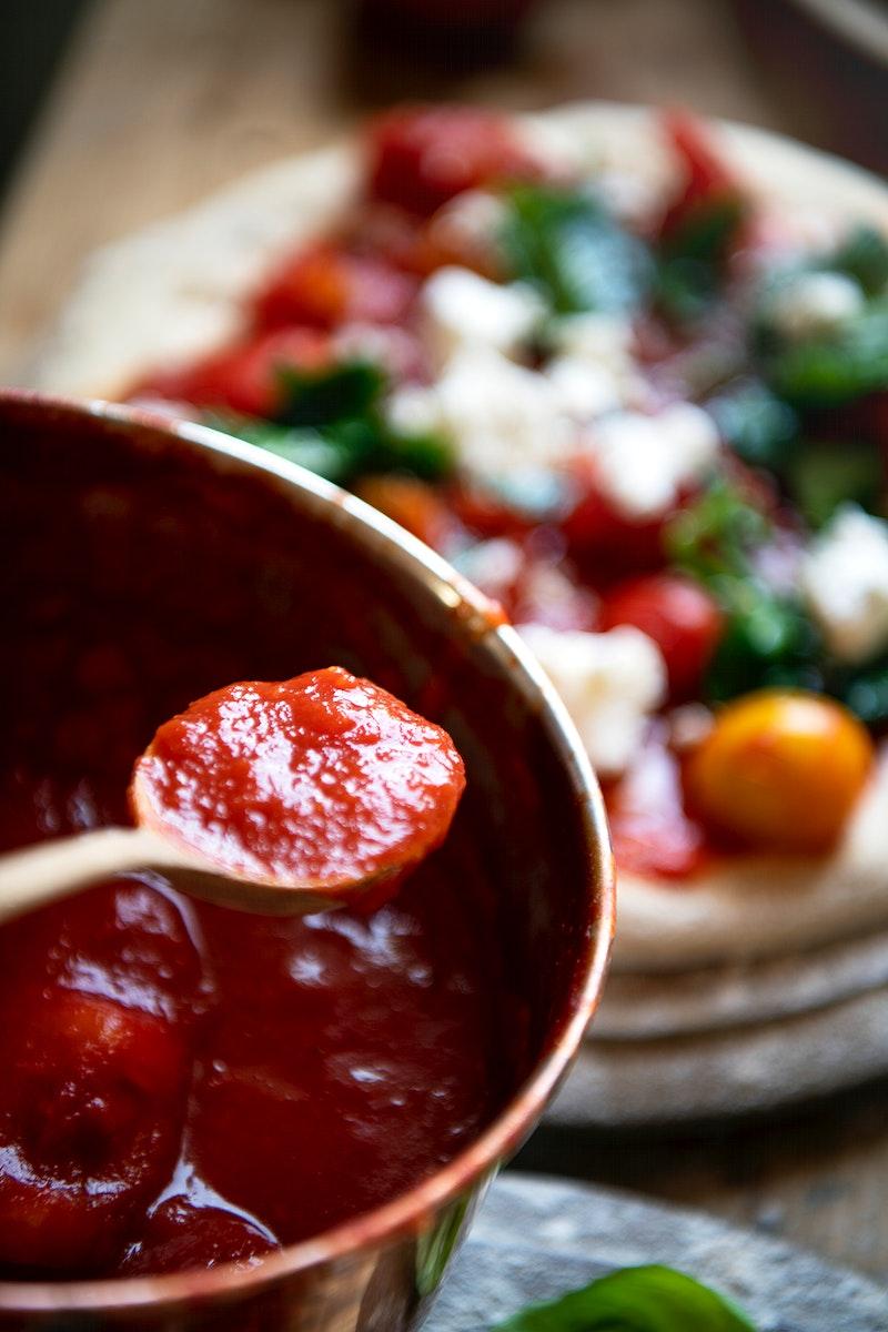 Homemade pizza and tomato sauce food photography recipe idea