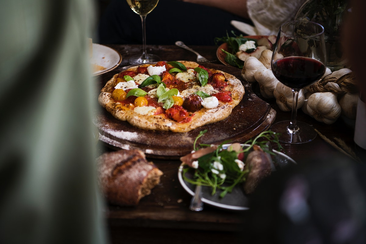 Homemade pizza for dinner with red wine