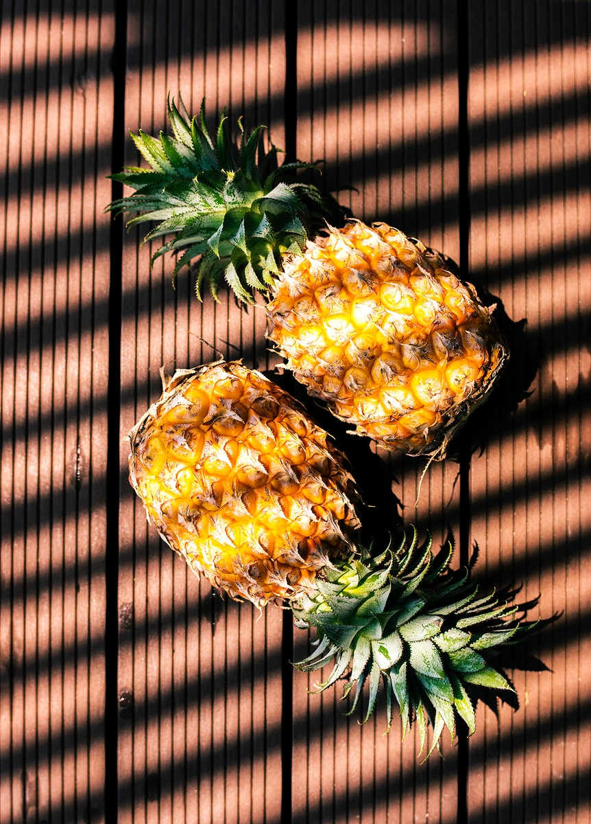 Pineapples with shadow from the light