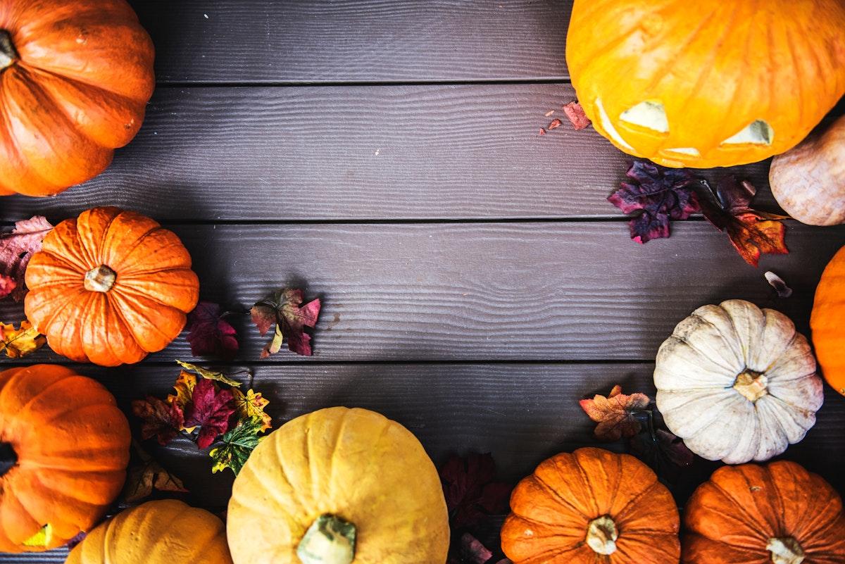 Halloween pumpkins on wooden background