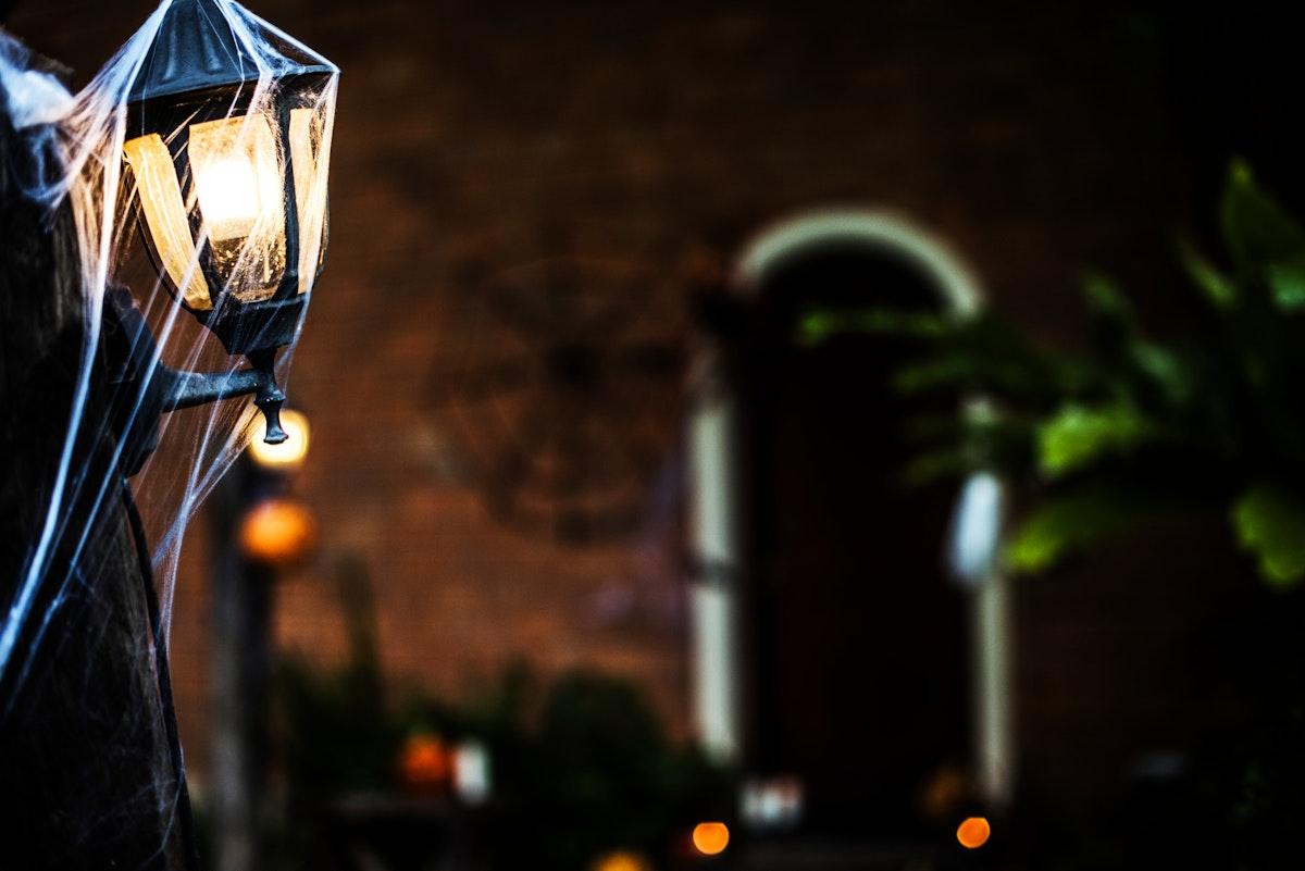 Light post with spiderweb on Halloween