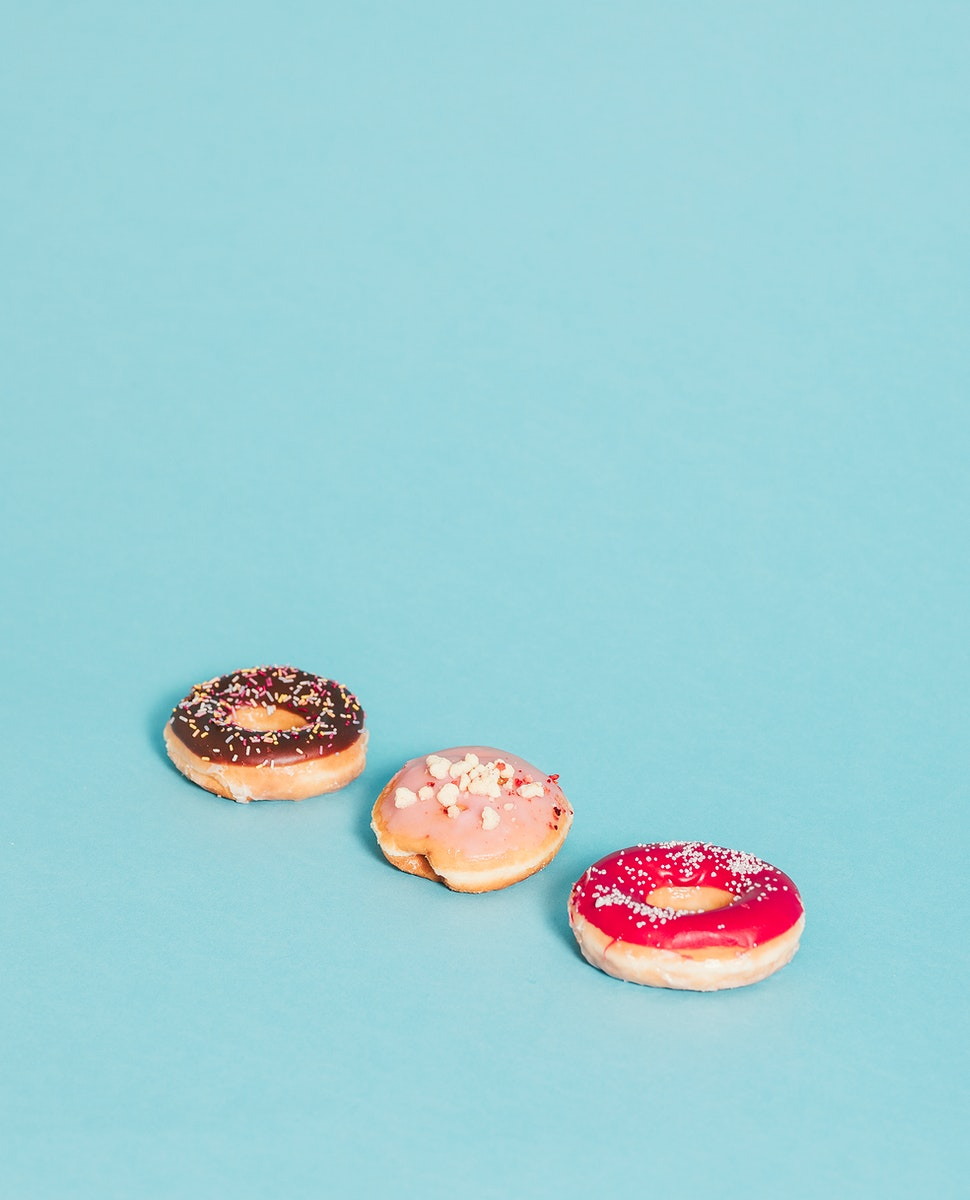 Colorful tasty glazed donut with sprinkles
