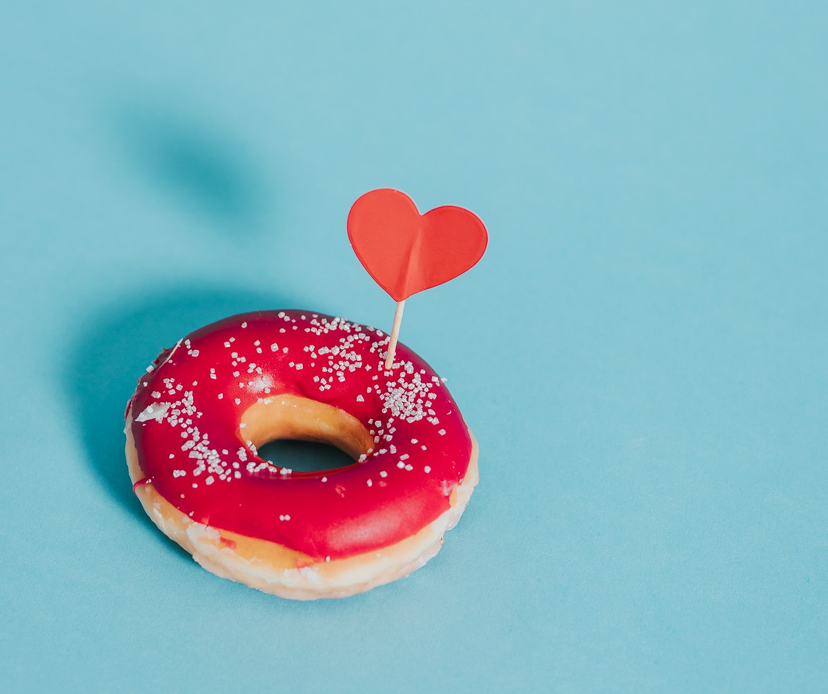 Tasty glazed donut decorated with a heart
