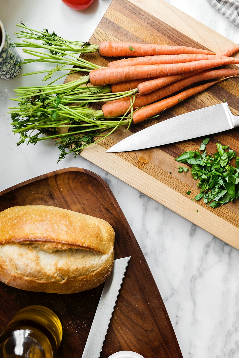 Sourdough bread and carrots on a cutting board