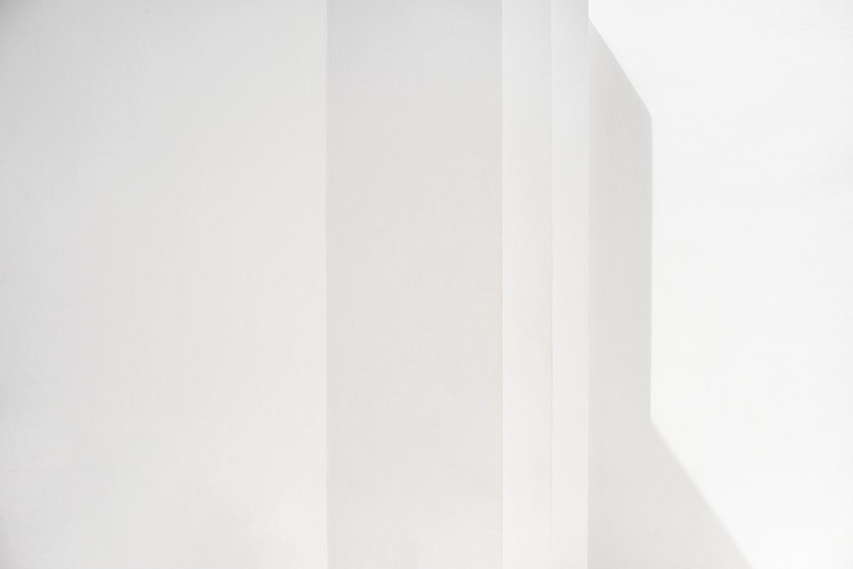 Blank white wall with shadows