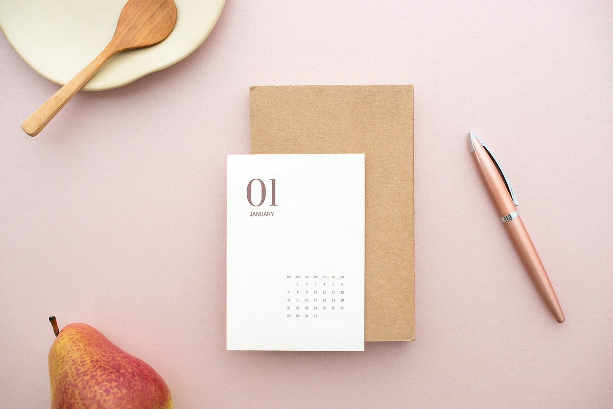 White card mockup on a pastel pink table