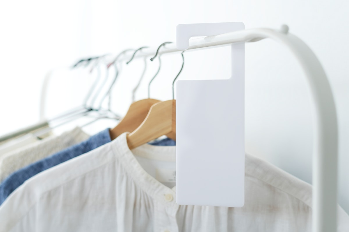 Shirt on a clothing rack with a tag mockup in a studio