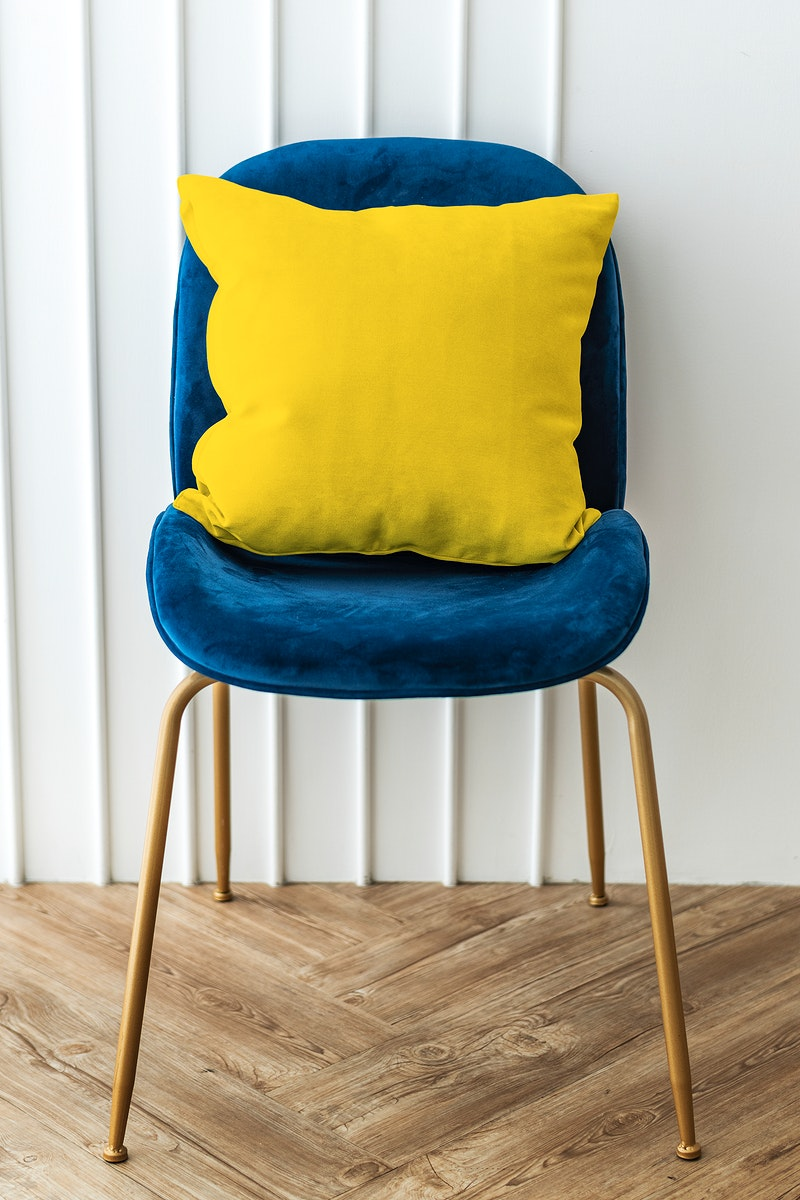 Yellow cushion on a blue velvet chair