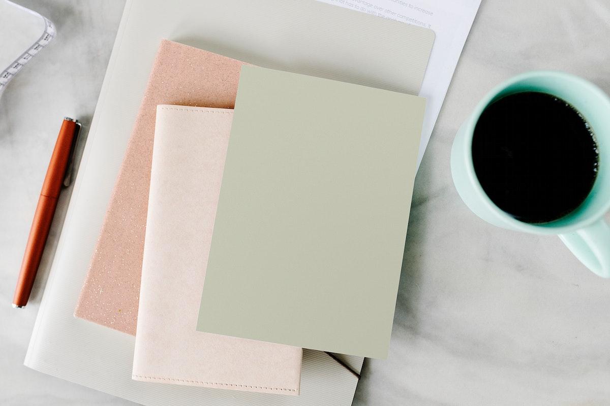 Coffee mug by a notebook mockup