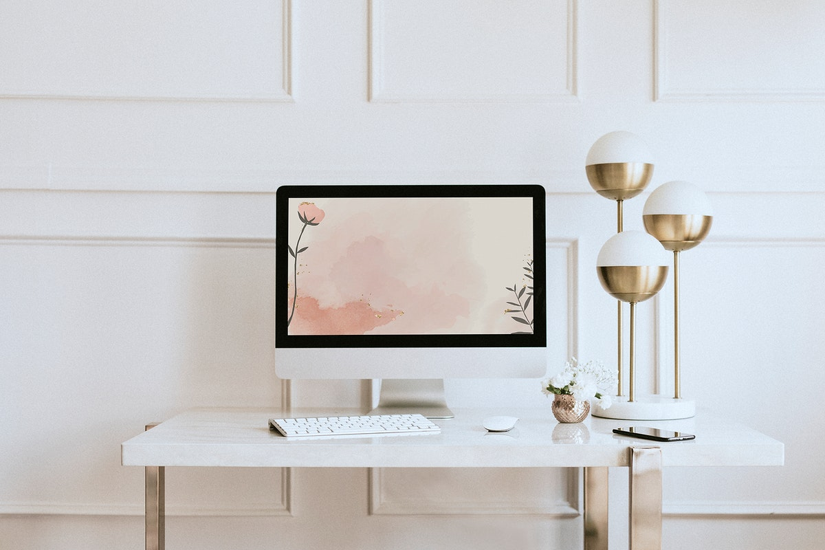 Computer screen mockup by a golden lamp