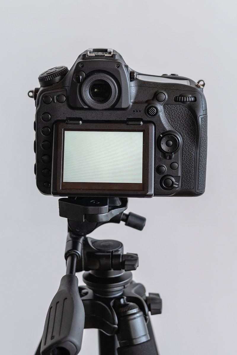 Digital camera on a tripod in a studio