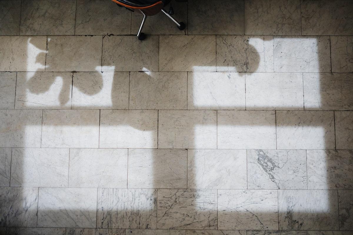 Shadows on a marble tile through the window