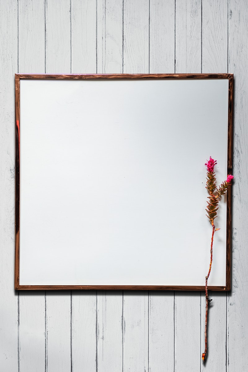 White picture frame mockup on a white wooden wall
