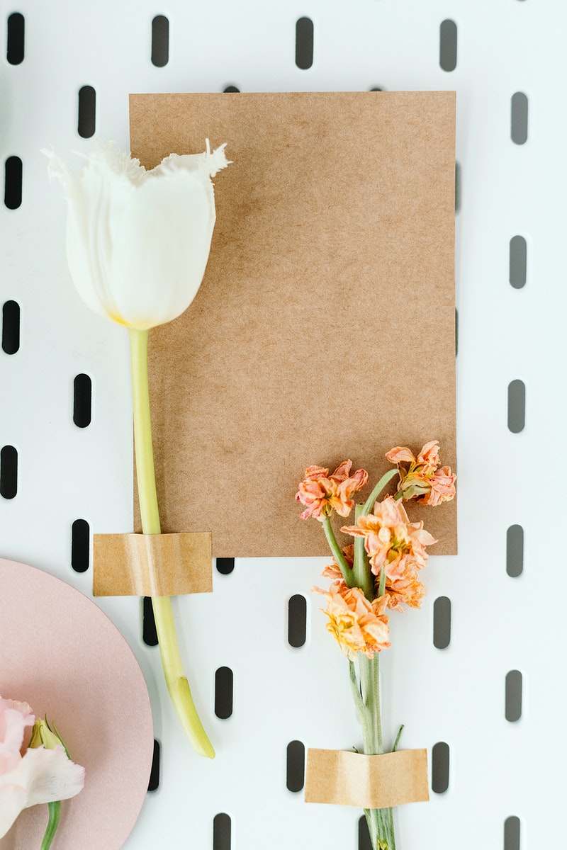 White parrot tulip and lathyrus peach with a brown card mockup