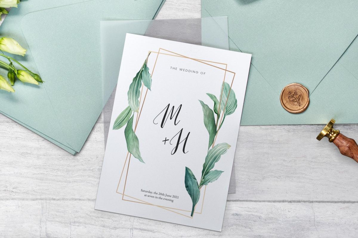 White lisianthus with a wedding invitation card mockup