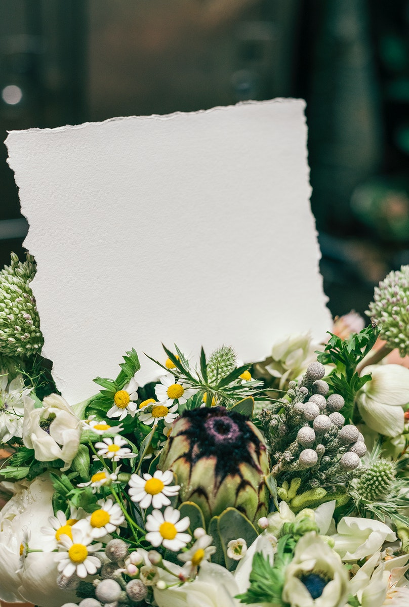 Bouquet of white flowers with a blank card