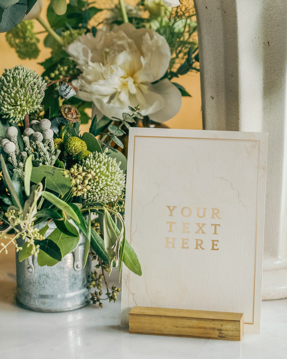 Bucket of fresh flowers with a card mockup
