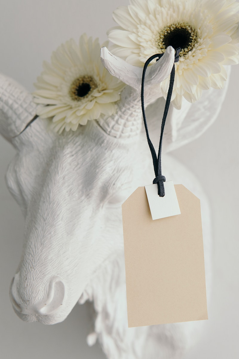 Tag mockup on a deer head decorated with flowers