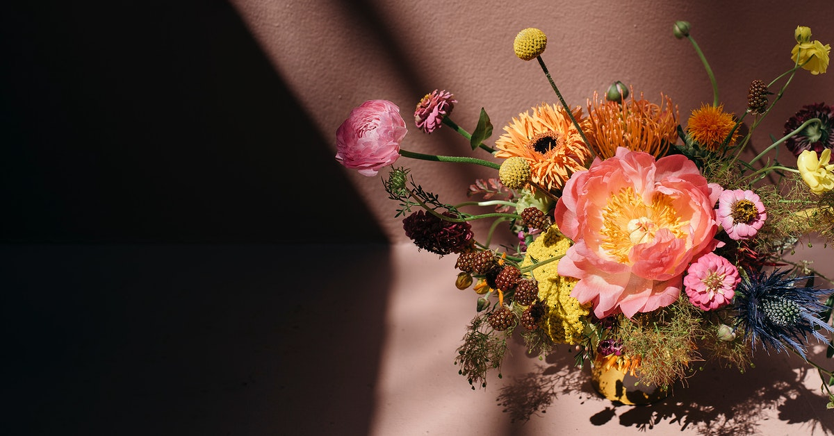 Colorful fresh flowers with pink background