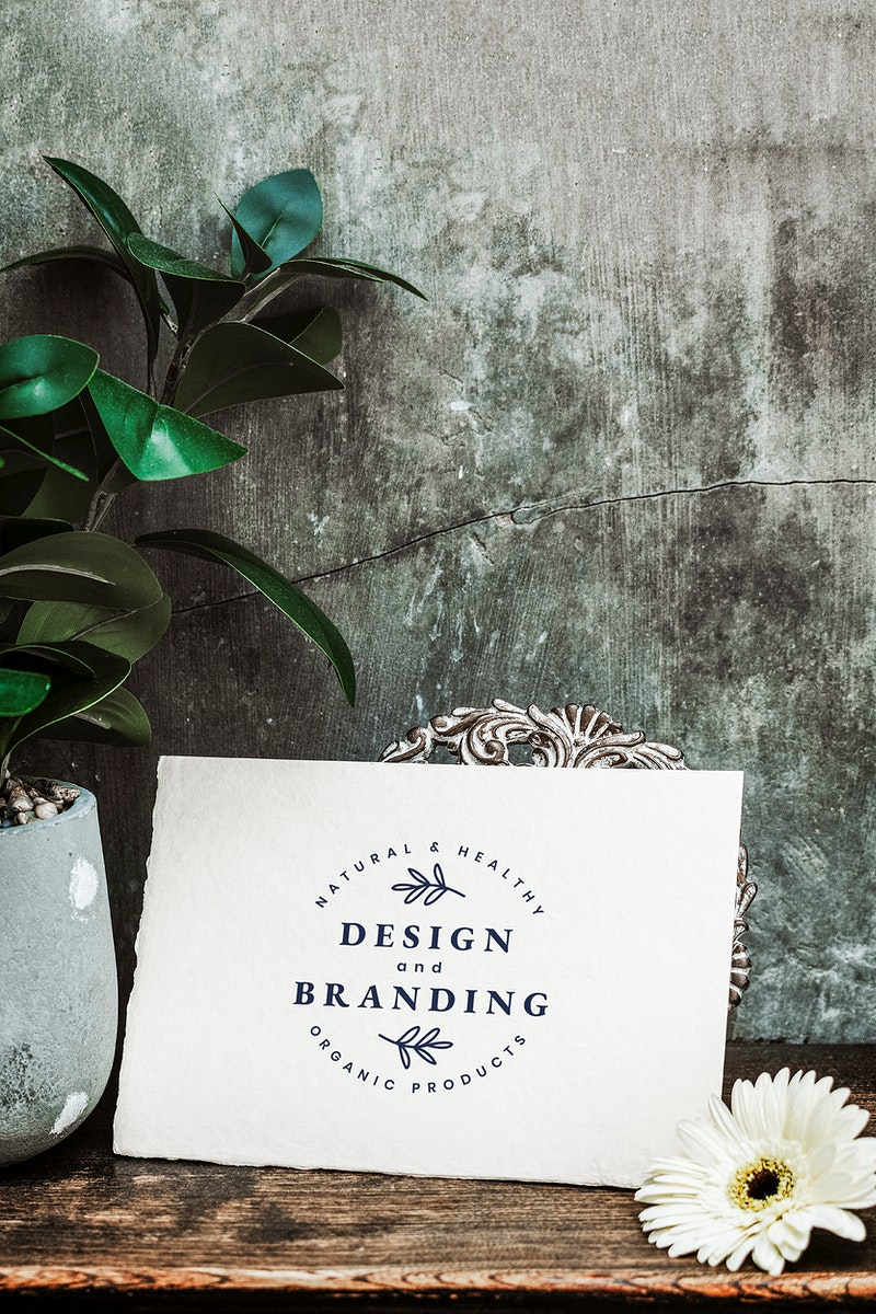Design and branding card mockup on a wooden table