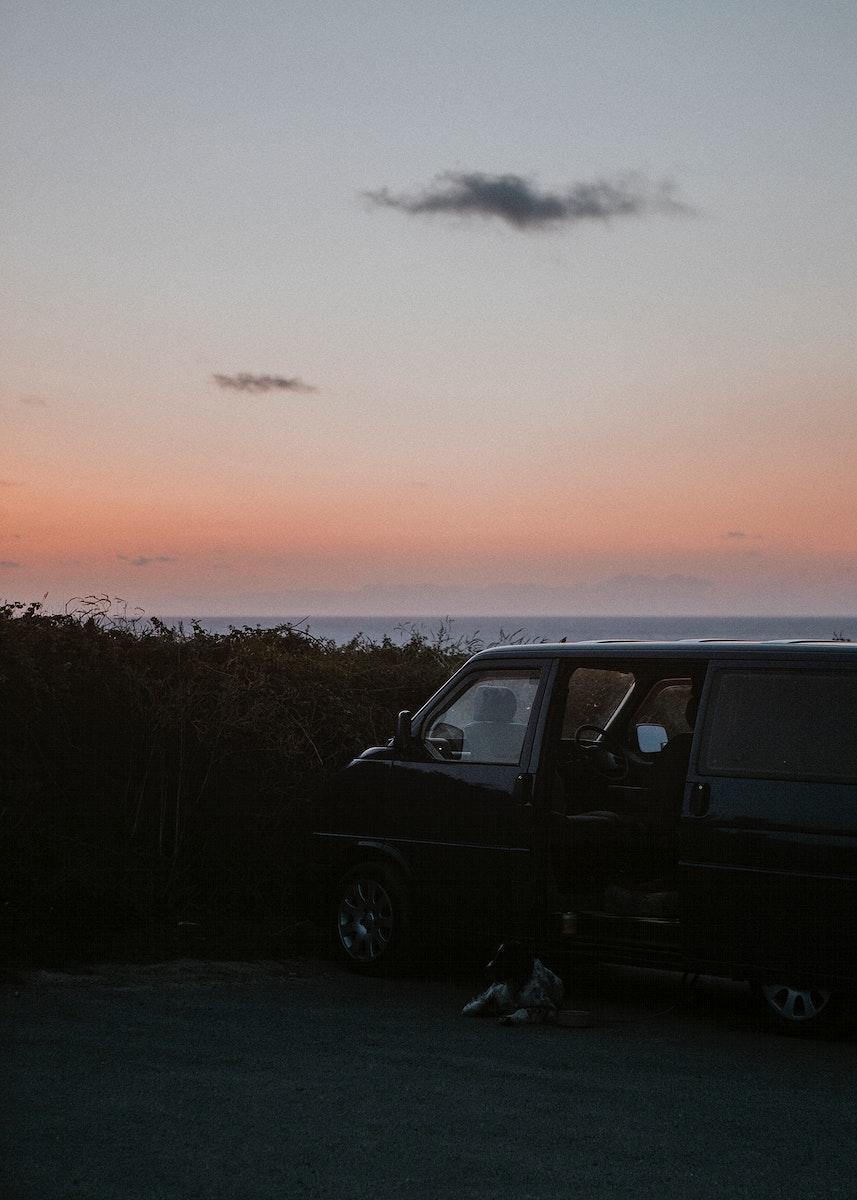 Jeep on a beach under an orange sky