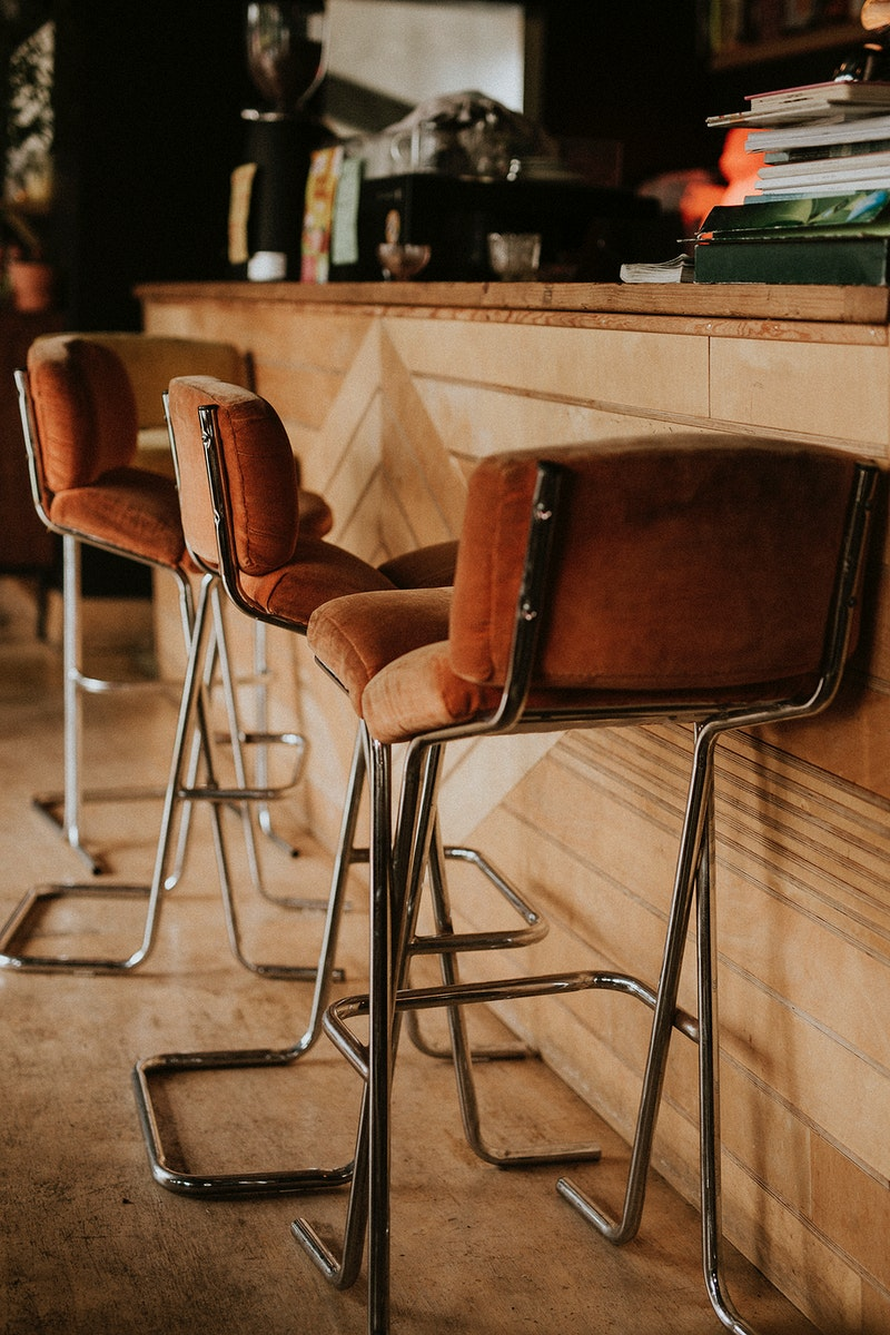 Brown soft stools in a cafe