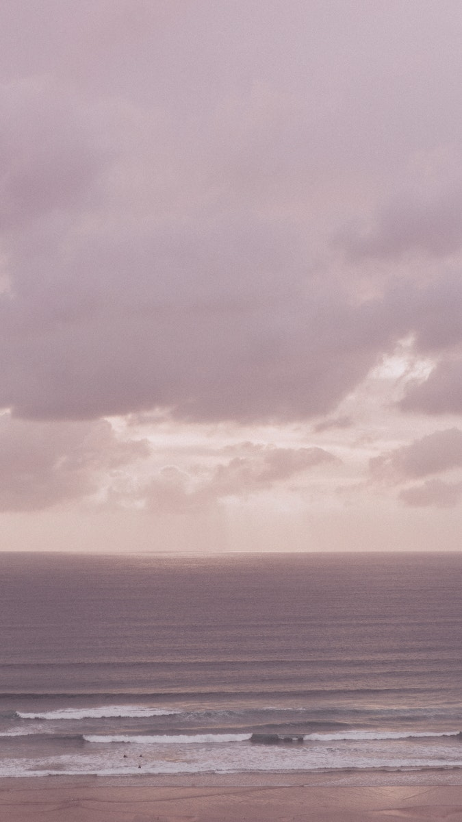 Pink cloudy sky over the sea