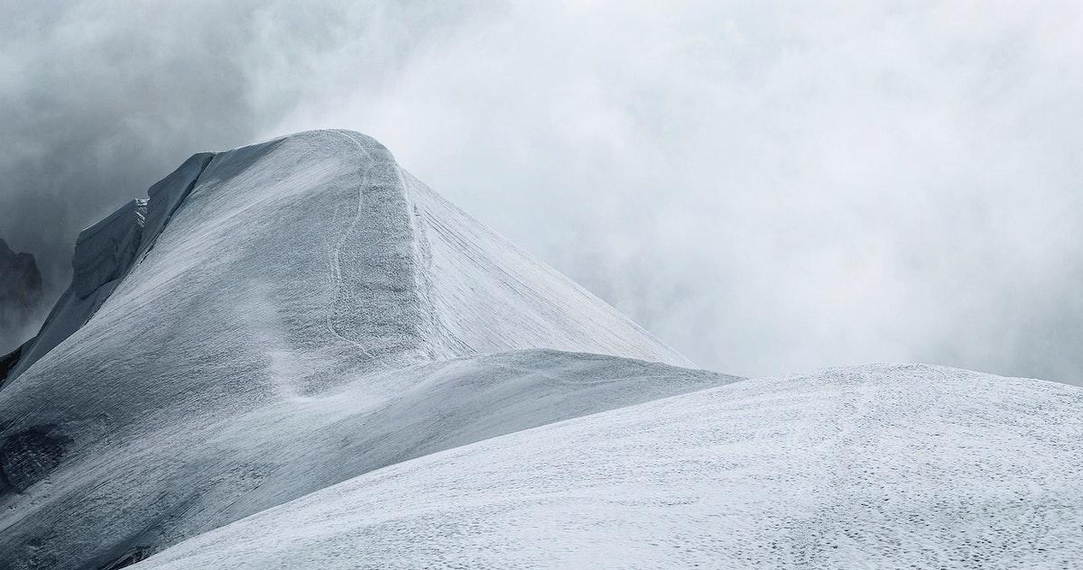 Cloudy snow covered Aiguille du Midi