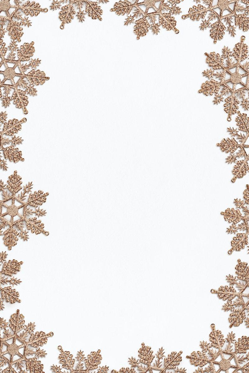 Festive golden snowflakes frame design
