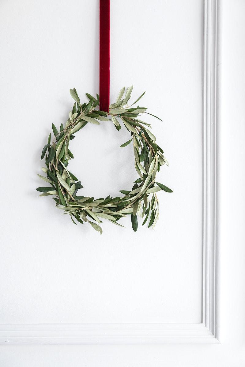 Eucalyptus Christmas wreath hanging on a white wall