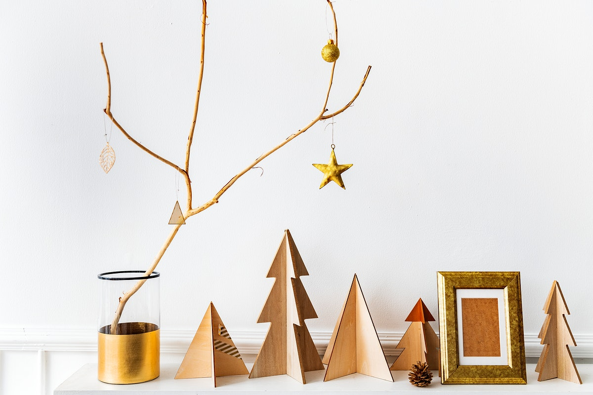 Golden photo frame surrounded by Christmas decor