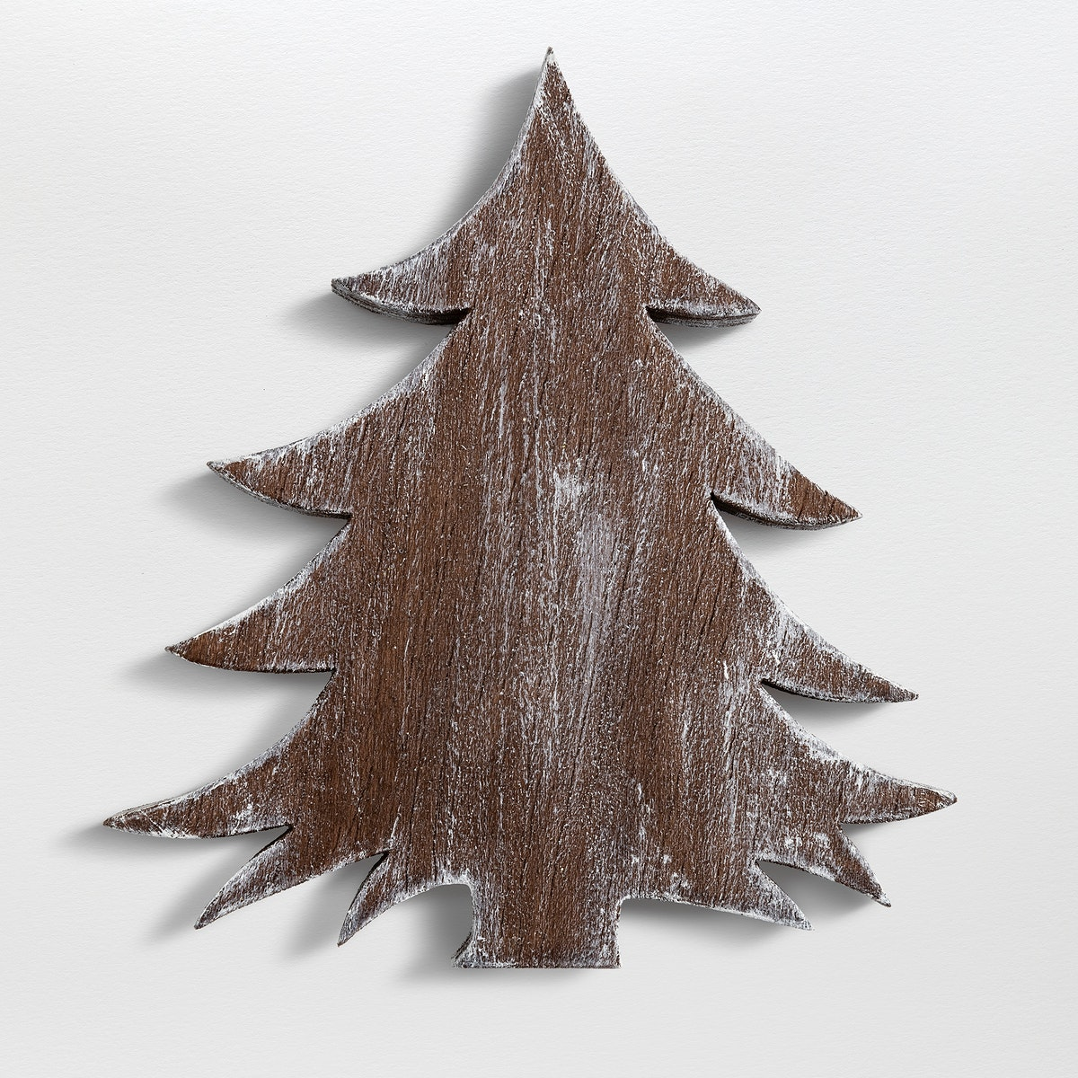 A Christmas wooden tree ornament isolated on gray background