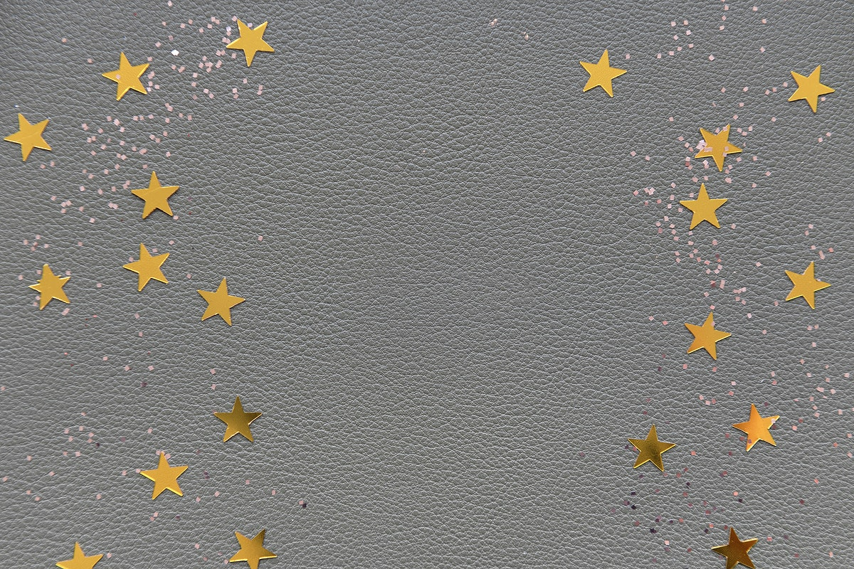 Golden stars on a gray background