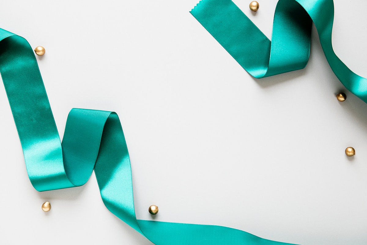 Green silky ribbon on a gray background