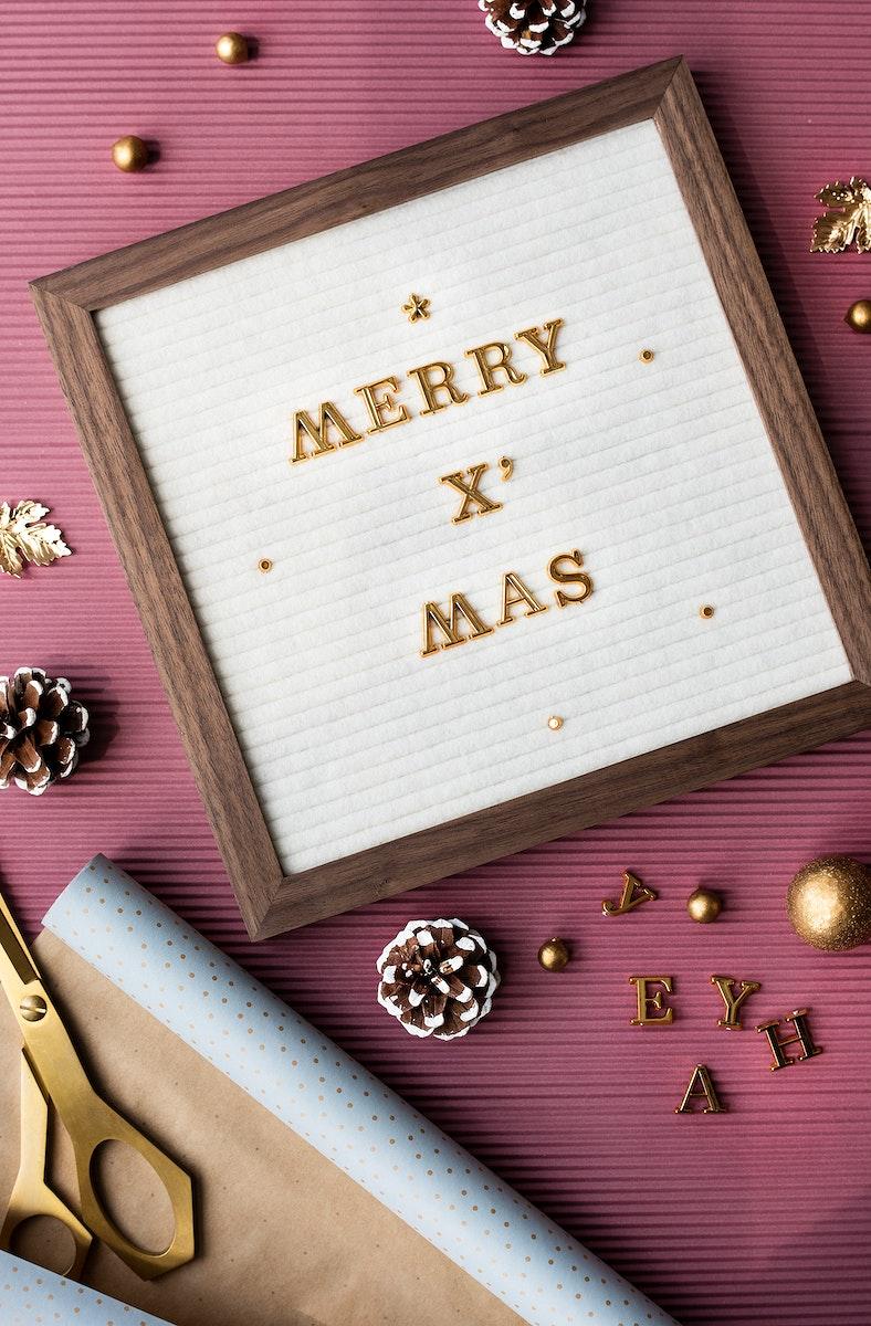 Golden merry Xmas in a wooden frame