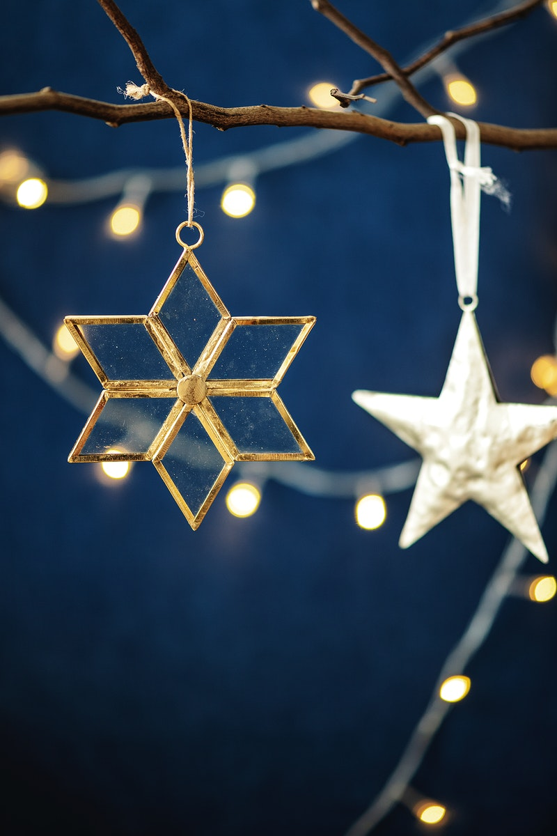 Festive golden snowflake hanging on a branch