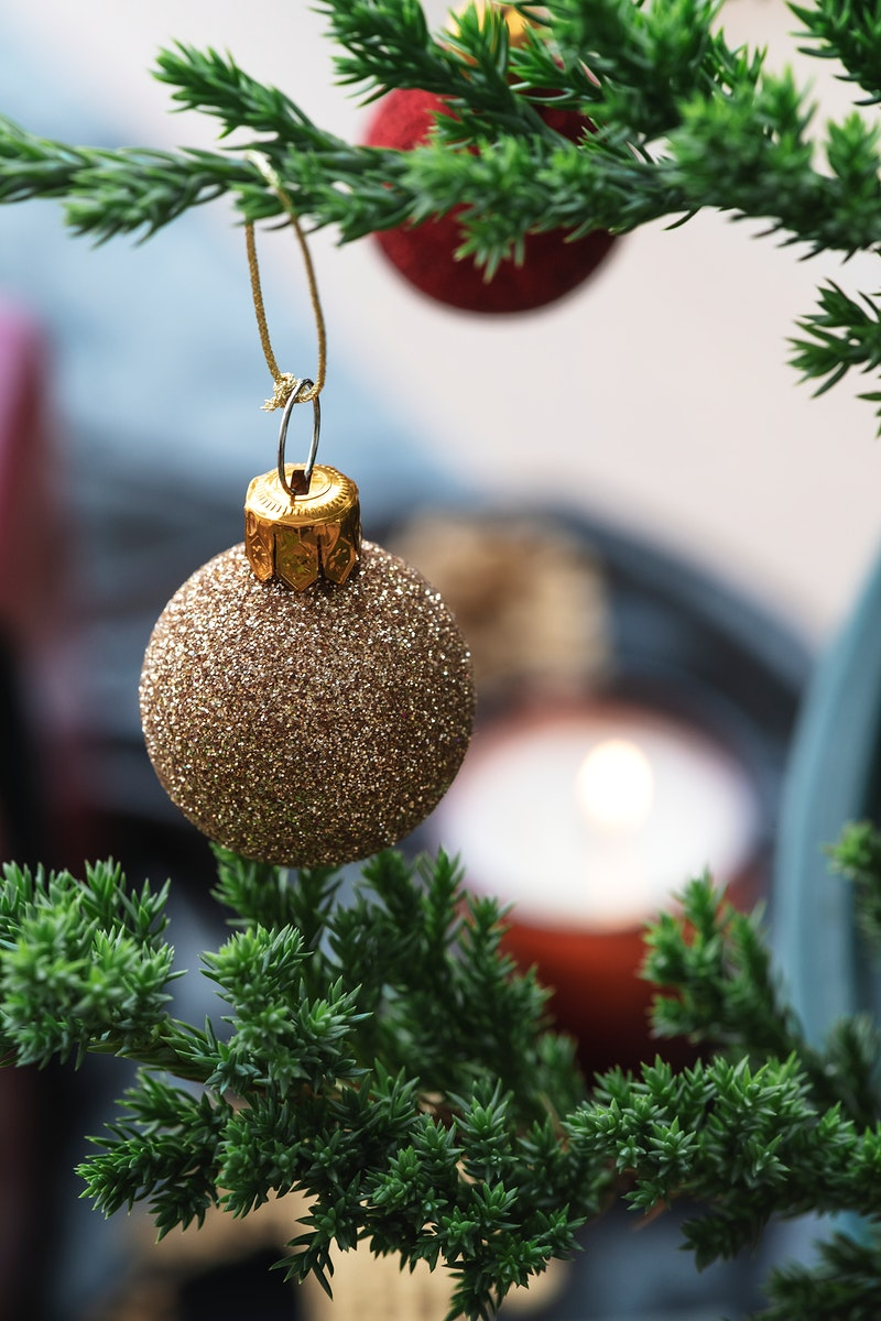 Festive shimmering bauble on a Christmas tree
