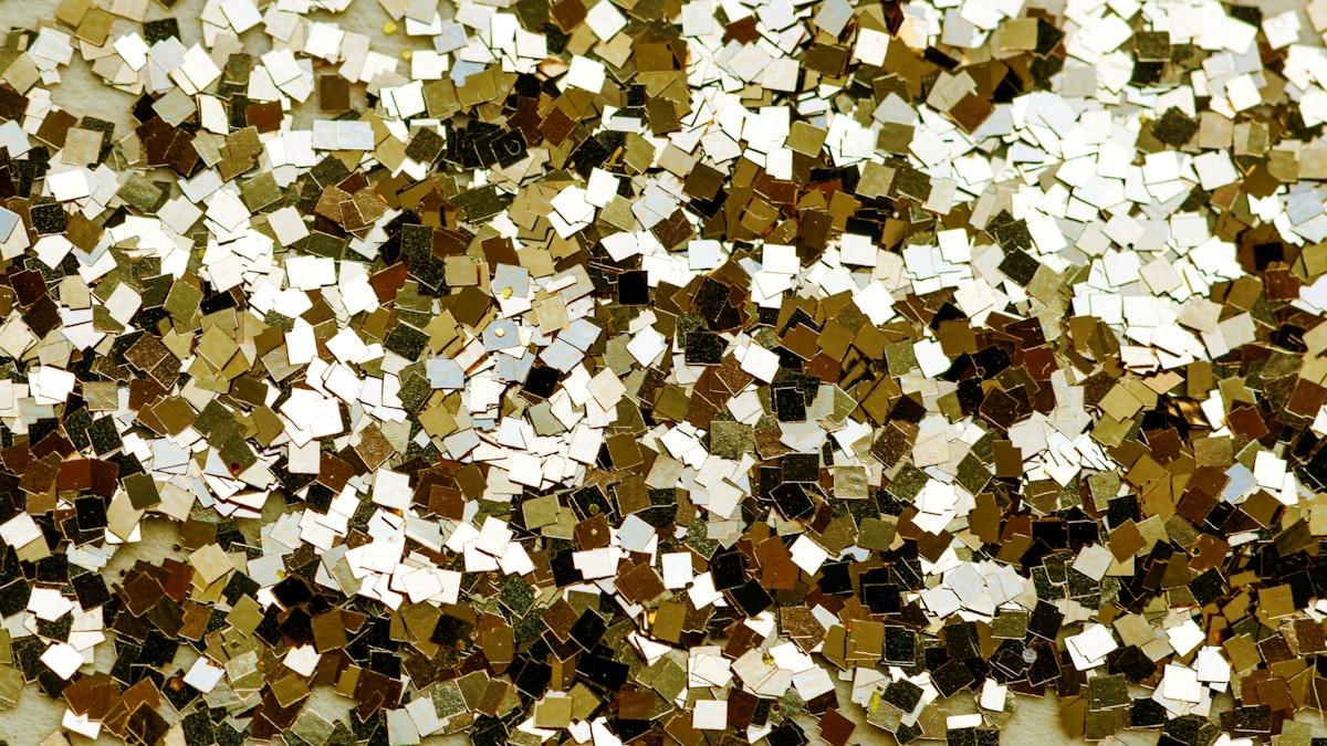 Festive golden sparkly sequin wallpaper