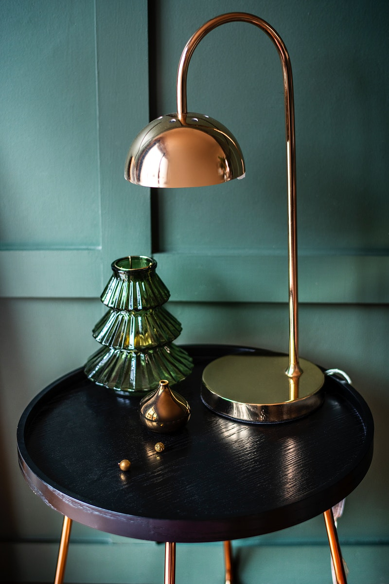 Rose gold shiny lamp on a table with Christmas ornaments