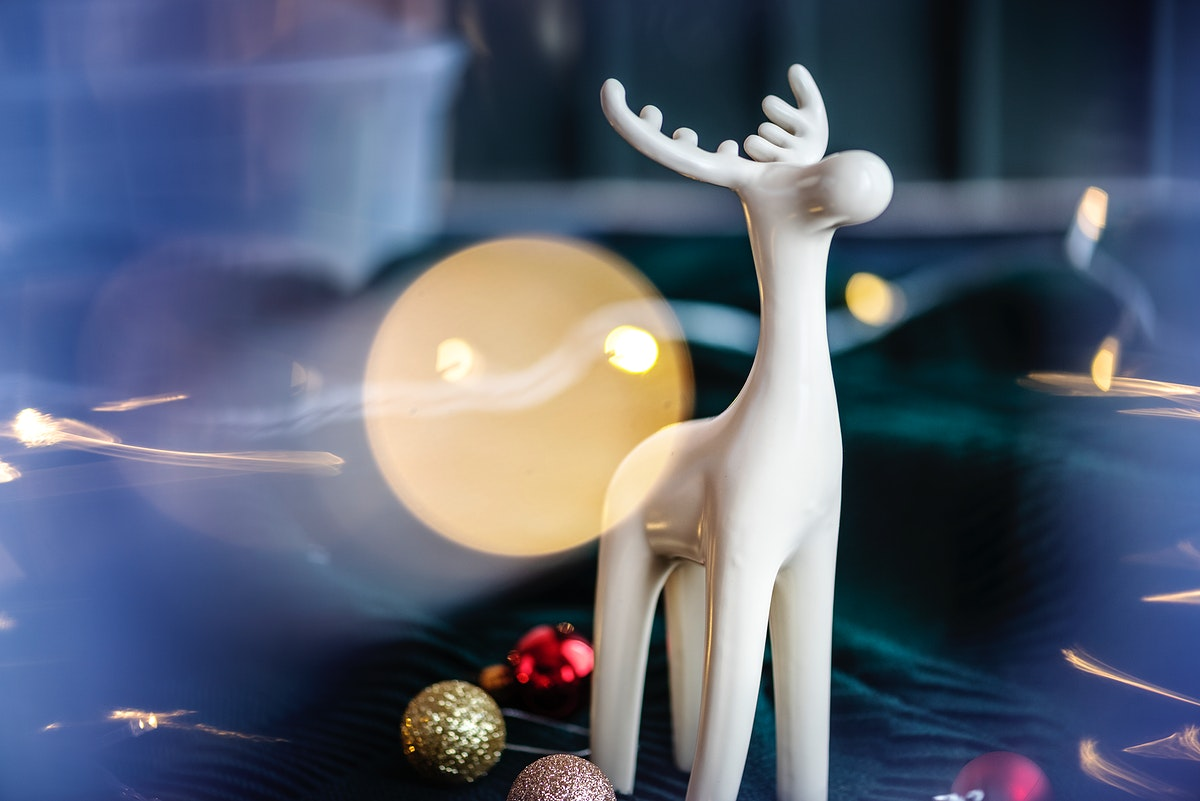 White reindeer surrounded by festive baubles