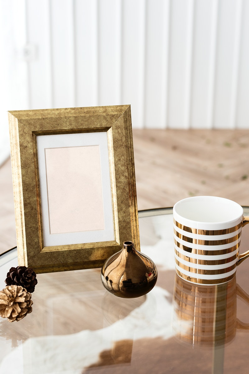Golden photo frame on a table