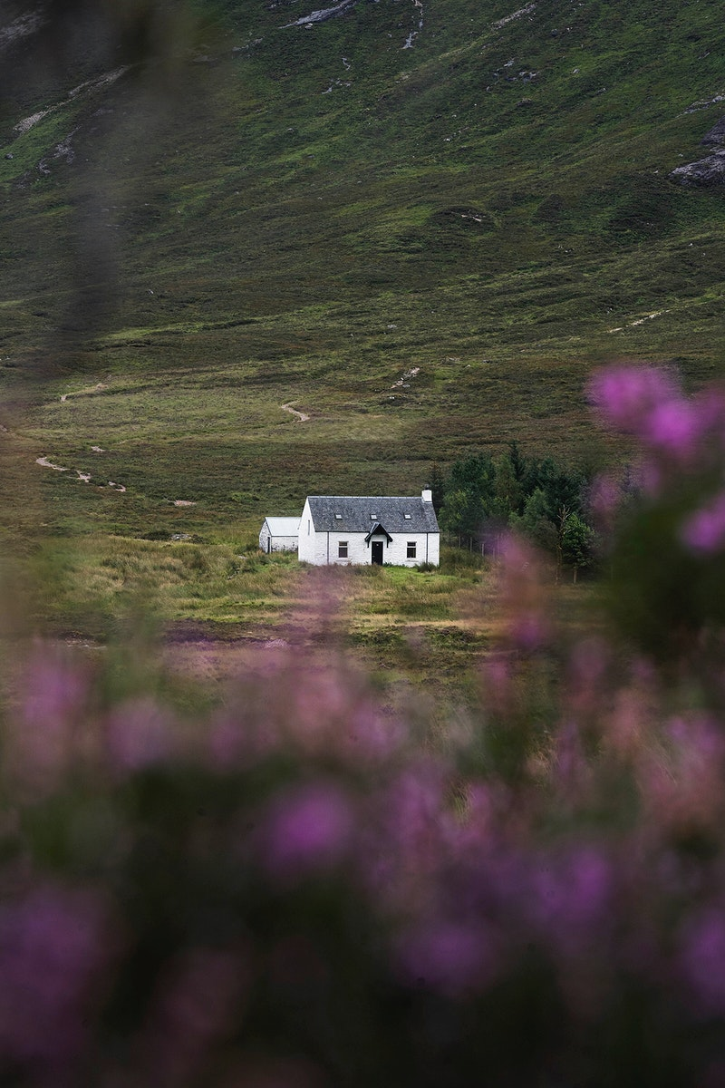 Drone view of cottage at Buachaille Etive Mor in Glen Coe, Scotland