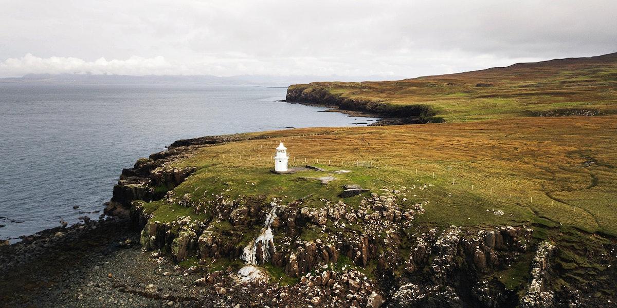 Drone shot of Vaternish Lighthouse at Isle of Skye, Scotland