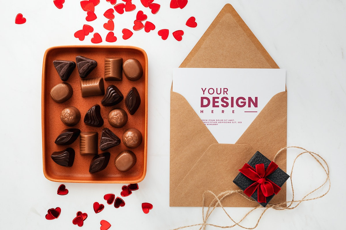 Valentines day card mockup by a tray of chocolates