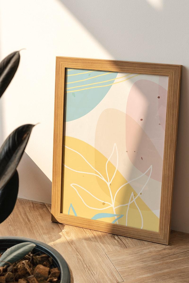 Wooden frame mockup on a wooden floor