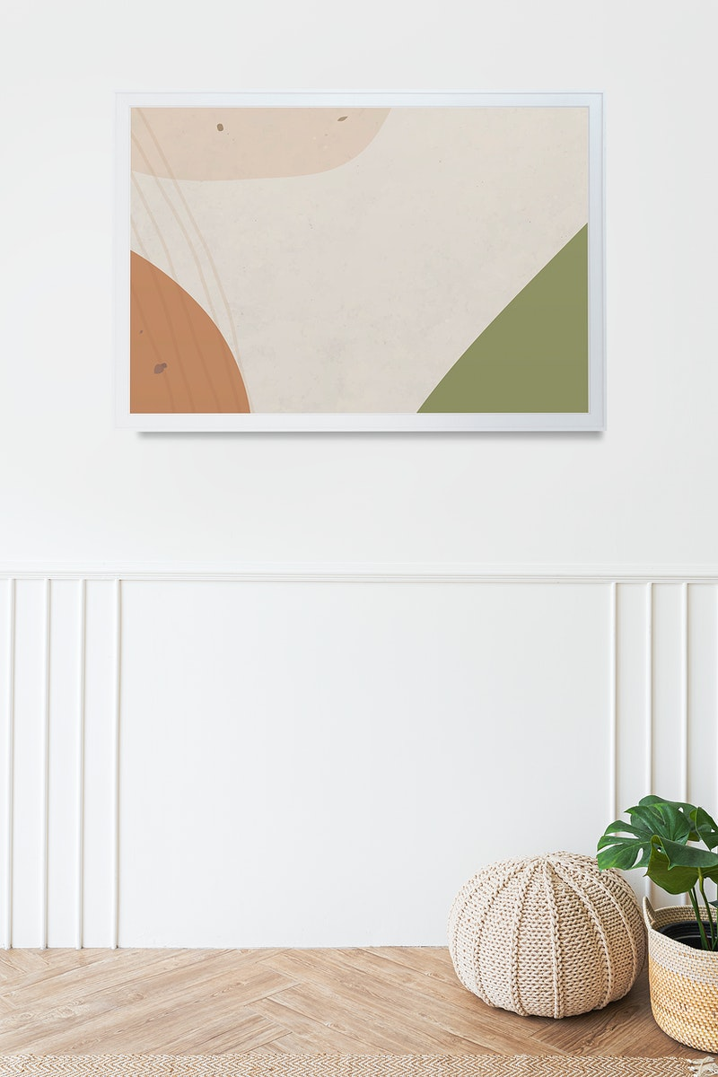Picture frame mockup hanging in a minimal white room