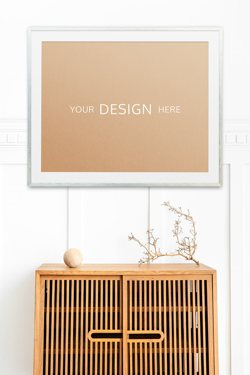 Picture frame mockup on a wooden cabinet